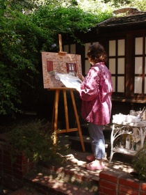 Artist, Carol Worthey at work (photo by Ray Korns)